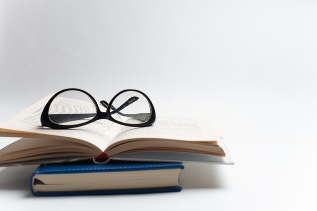 notebook-with-glasses-pen-book-with-glasses-blue-notebook-with-glasses-book-with-cup-tea_79783-119